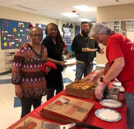 Serving Pizza to NC Members-April 2018